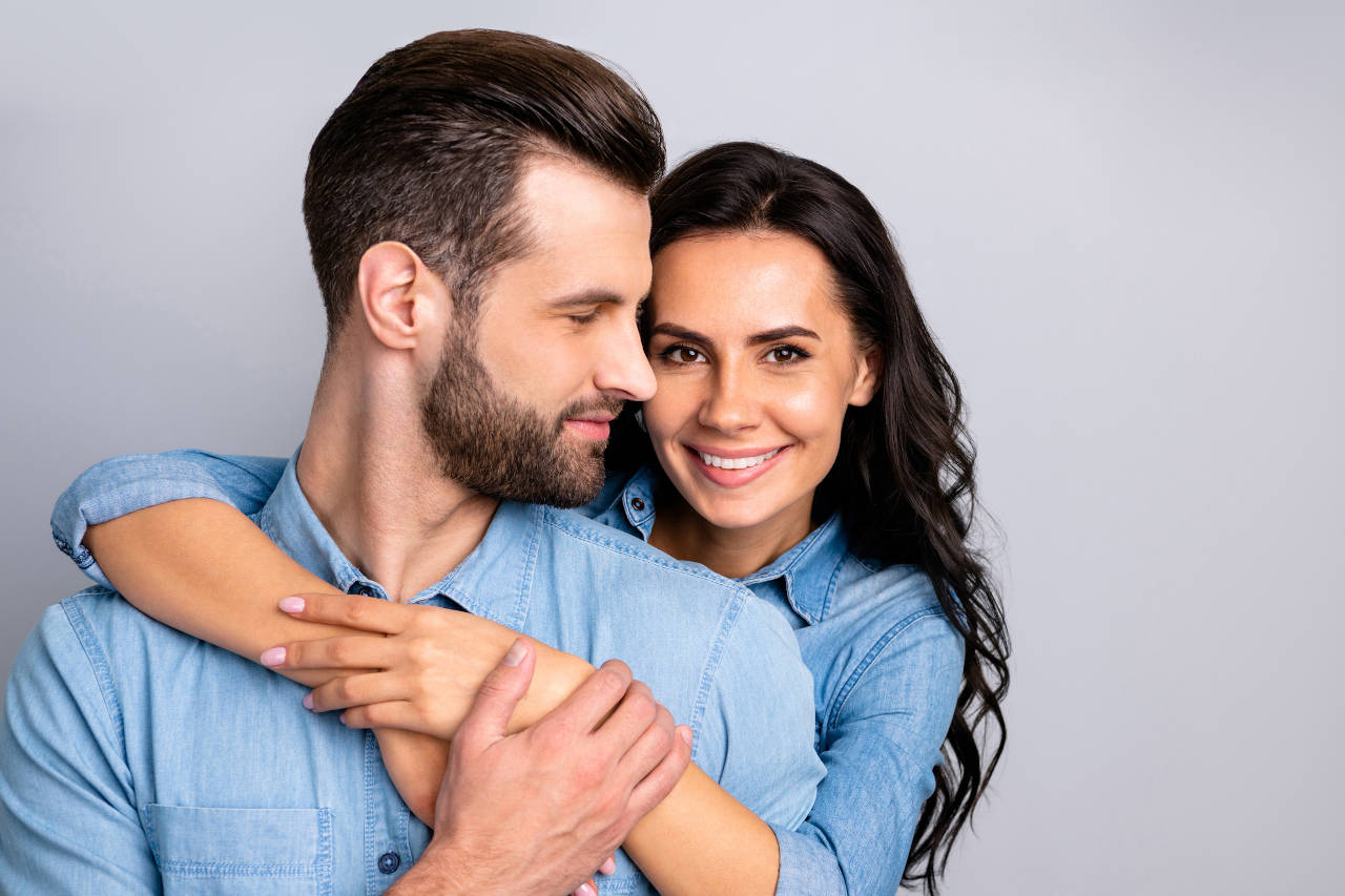 woman hugging man with beautiful hair