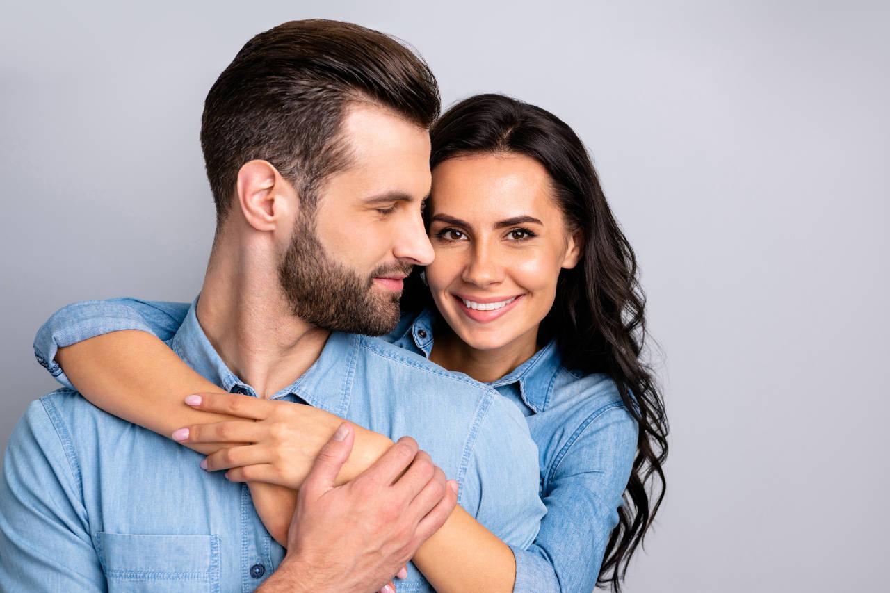 woman hugging man with beautiful hair